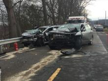 Two vehicles remain in the roadway after they collided along the Mifflinville-Nescopeck Highway. (Press Enterprise/Kristin Baver)