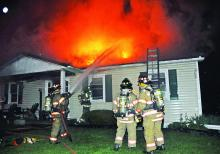 Firefighters battle a blaze at 44 Slate Road in Madison Township Saturday night.