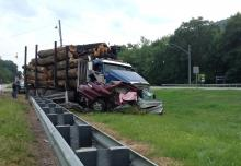 Officials say it appears a woman pulled her car into the path of a log truck at the intersection of Routes 54 and 642 on Wednesday. (Press Enterprise/Chris Krepich)