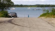 Two men walk on the boat ramp at the scene of a double fatal accident, Wednesday July 24, 2013, in Roque Bluffs, Maine. A pregnant Maine woman and her friend visiting from Pennsylvania got lost hiking and were rescued but died later that evening, authorities said, when they accidentally drove their car into the water. (AP Photo/Washington County Sheriff's Department, Lt. Travis Willey)