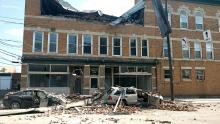 The third floor of 102-106 E. Second St., Berwick, collapsed onto traffic in the turn lane of the road Wednesday. (Press Enterprise/Jimmy May)