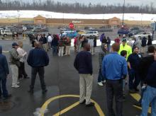 People gather in the parking lot of a car wash at the Buckhorn Plaza during an evacuation of the Walmart on Friday. (Press Enterprise/Jimmy May)