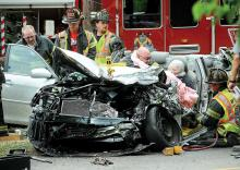 Berwick Rescue crews work to free Patricia McLaughlin, 76, of Bloomsburg from her car Thursday after she collided with a pickup truck along Route 11 at Rittenhouse Mill Road in Briar Creek Borough. (Press Enterprise/Keith Haupt)