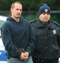 Scott David Navara, Freeland, is taken into a district judge's office by Bloomsburg Matt Golla Wednesday morning to be arraigned on burglary charges. Navara is accused of breaking into the Wesley United Methodist Church on Market Street in Bloomsburg early Wednesday morning.
