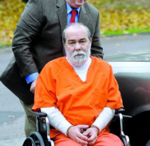 Thomas Mensch outside a courtroom in November 2011. Mensch pleaded guilty but mentally ill Monday for a shootout with police he said was triggered by flashbacks to Vietnam. (File photo)