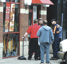 Love's Travel Stop officials look for ways to repair the smashed window at the truck stop in Mifflinville Wednesday afternoon. Elan Summers of Turbotville jumped the curb and smashed into the window of the Arby's Restaurant. (Press Enterprise/Keith Haupt)