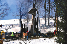 Firefighters stand at the still-smoldering remains of a house at the end of a lane off White Horse Pike in Greenwood Township on Friday morning. State Police fire marshals are investigating. (Press Enterprise/Bill Hughes)