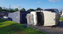 A tractor trailer rests on its side on Commerce Drive following an accident Saturday night