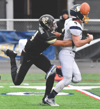 Southern Columbia's Julian Fleming, left, runs down Wilmington's Colton Marett and knocks the ball free forcing the fumble in the first quarter which Southern would recover during the ball during the PIAA Class 2A State Championship.