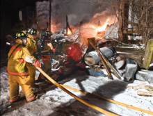 Firefighters battle a blaze at a pole building on the Whistle Stop property along Railroad Street in Catawissa. (Press Enterprise/Keith Haupt)