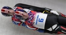 The doubles team of Christian Niccum and Jayson Terdiman of the United States speed down the track in their final run during the men's doubles luge at the 2014 Winter Olympics, Wednesday, in Krasnaya Polyana, Russia. (AP Photo/Michael Sohn)
