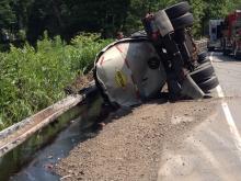 This tanker overturned along Route 487 Monday, spilling tar into Fishing Creek in Orange Township. (Press Enterprise/John-Erik Koslosky)